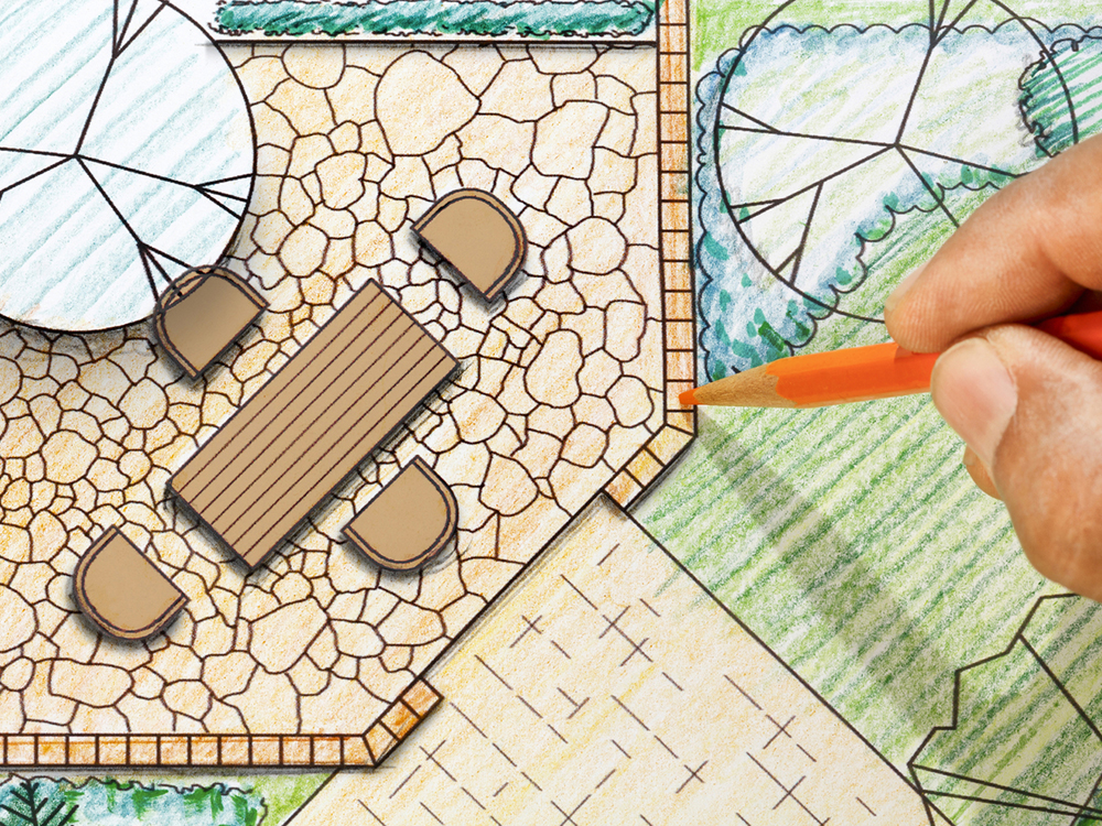 Garden Design plans, hand colouring in with orange pencil